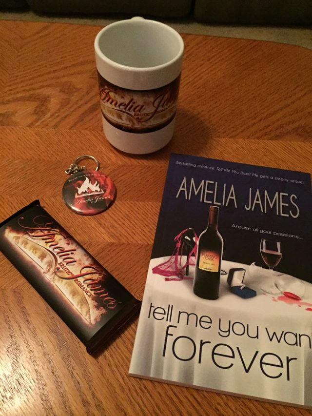 Signed paperback, coffee mug, chocolate bar, and keychain